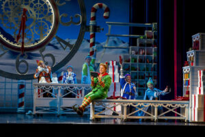 Ben Forster as Buddy with the Elves - Photo: Alastair Muir