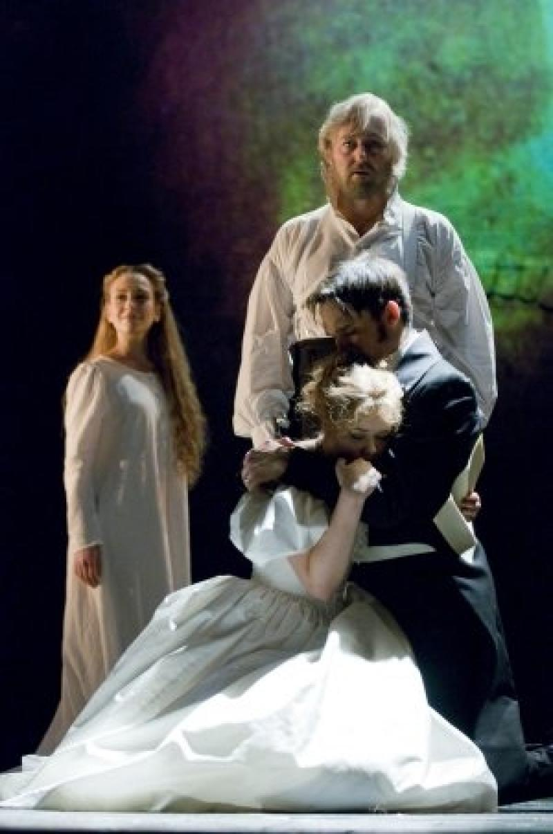 Madalena Alberto as Fantine (left), John Owen-Jones as Valjean (back right), Gareth Gates as Marius and Katie Hall as Cosette (front right) - Photo: Michael Le Poer Trench