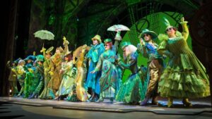 Company in Wicked - Photo: Tristram Kenton