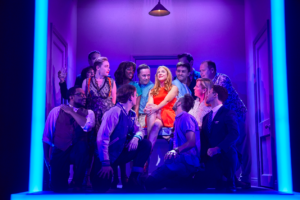 Rosalie Craig as Bobbie (centre) with the cast of Company - Photo: Brinkhoff/Mogenberg
